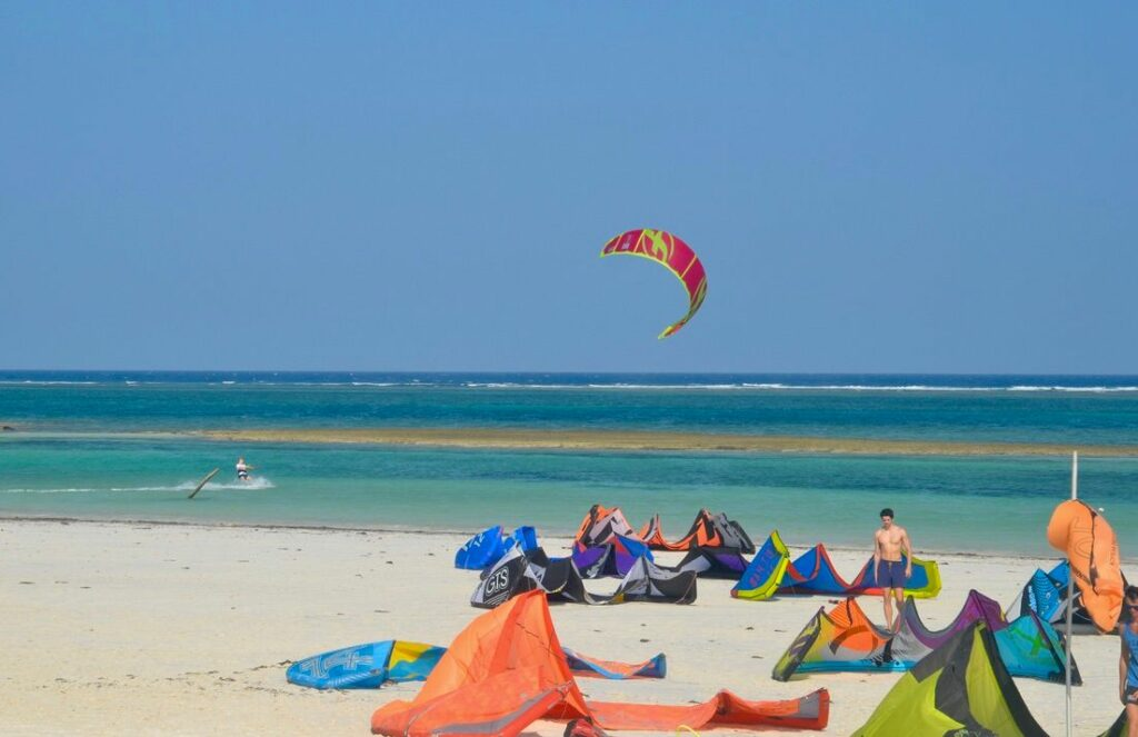 Kitesurfing by beach